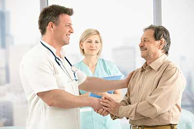 doctor and man shaking hands